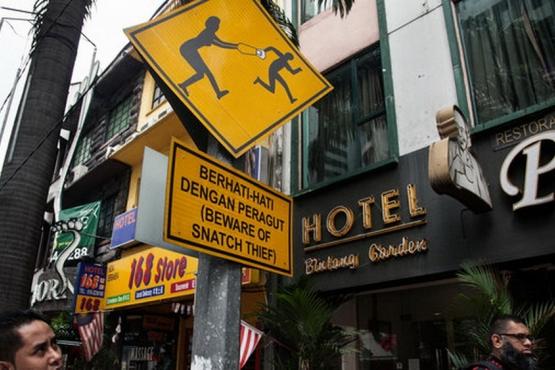 Подобные знаки не случайно украшают центральные районы малайских городов